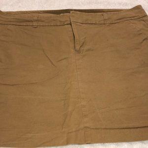 Khaki mini skirt.